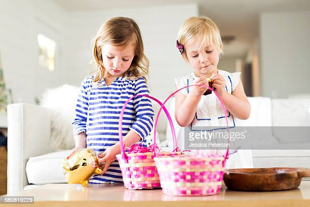 Girls (2-3, 4-5) opening candies