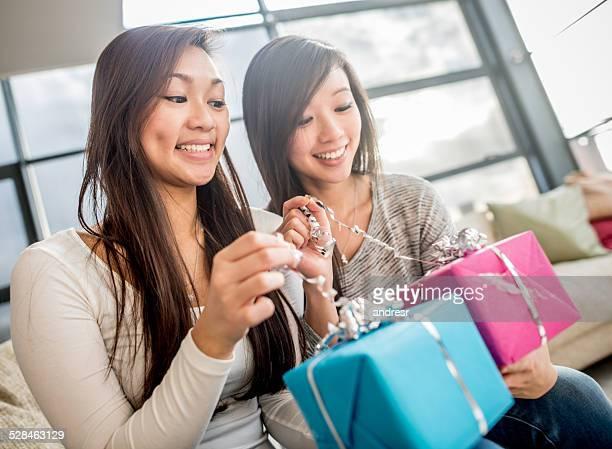 Girls opening presents
