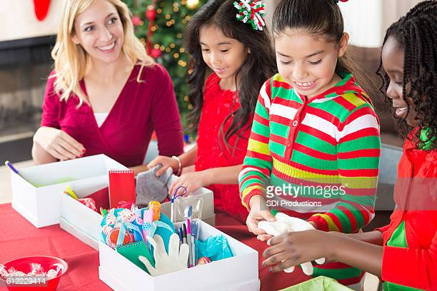 Girls pack shoe boxes for Christmas charity project