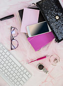Girls' party set. Flat lay With female tricks. Glasses, smartphone, black bright Shiny Clutch, Pen, jewelry and accessories.