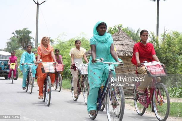 Girls pedal their way back to Khanpakri 7 kms fom the High School Desari in Vaishali district in Bihar after attending classes on the bicycles...