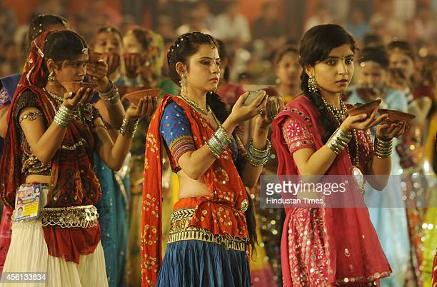 Girls perform aarti on the first day of Navratri festival near Madan Mahal garden on September 25 2014 in Indore India Hindu festival of Navratri is...
