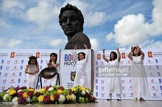 Girls perform during the ceremony of the lighting of the 'Flame of Friendship' with which the Special Olympics 'Fides' are inaugurated in Bogota...