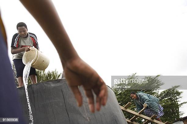 Girls perform their daily chores at the Tasaru Safehouse for Girls December 29 2006 in Narok Kenya The Tasaru Safehouse supports board lodging and...