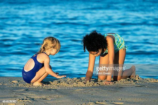 Girls play at the beach