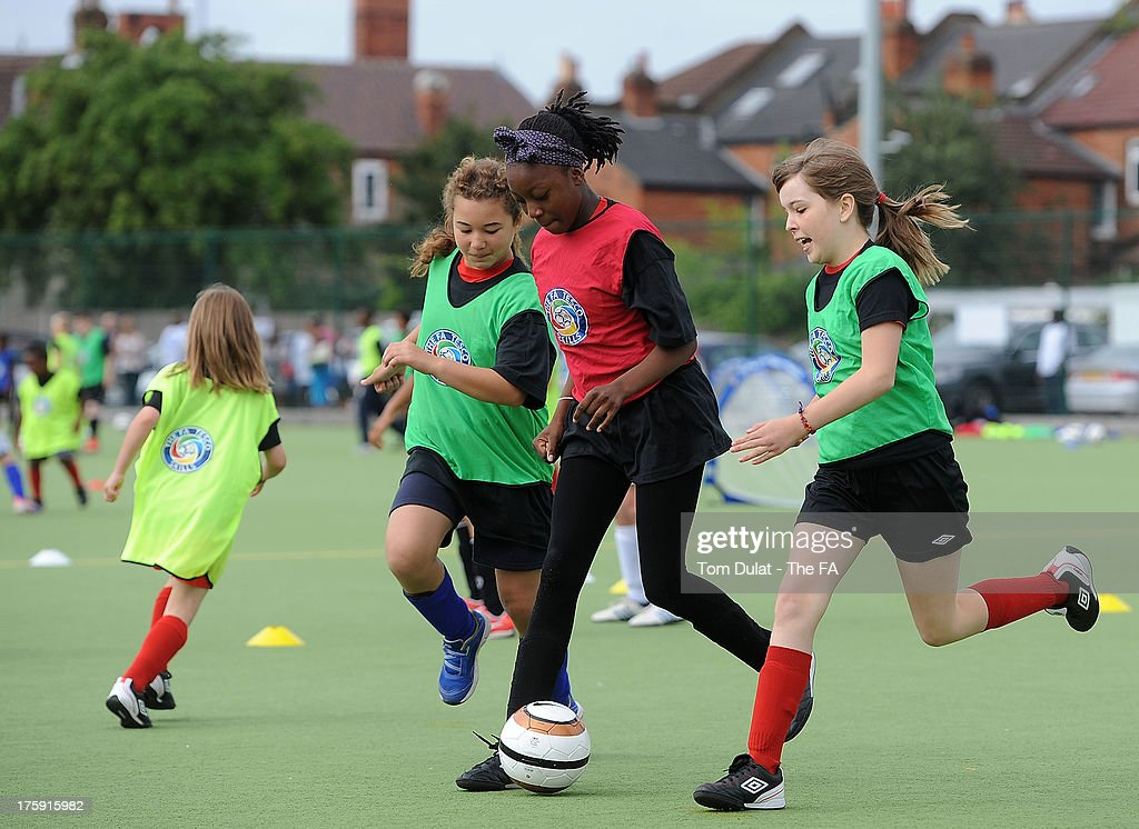 Girls play football during The FA's Sir Bobby Robson National Football Day at Kings College Sports Ground on August 10, 2013 in London, England.
