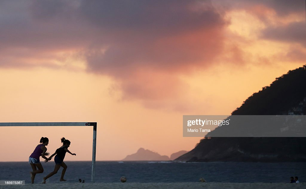 Girls play soccer on Ipanema Beach on October 26, 2013 in Rio de Janeiro, Brazil. Brazil is gearing up to host the 2014 FIFA World Cup and Rio 2016 Olympic Games.