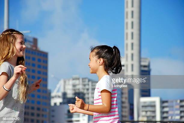 Girls Playing against Urban Scene