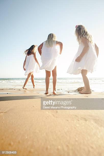 3 girls playing at beach