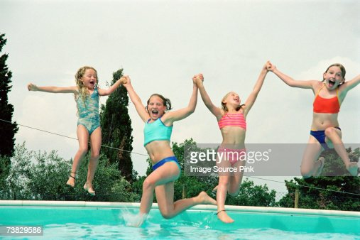 Girls playing at the pool : Foto stock