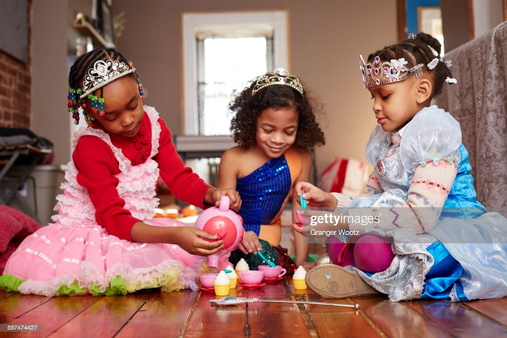 girls playing dressup at tea party stock photo getty images. Black Bedroom Furniture Sets. Home Design Ideas