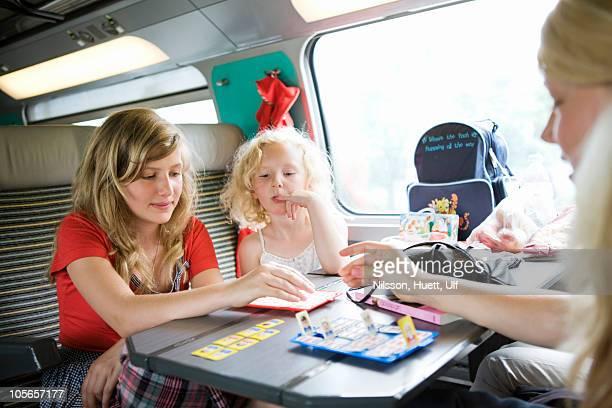 Girls playing game in train