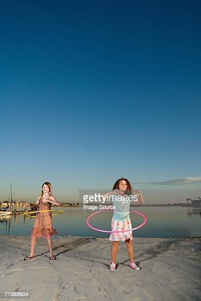 Girls playing hula hoop
