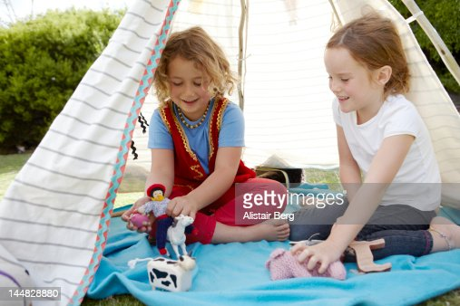 Girls playing in a tent : Stock Photo