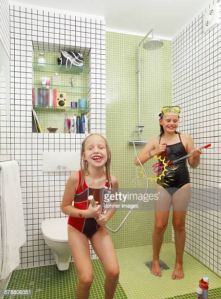 Girls playing in bathroom