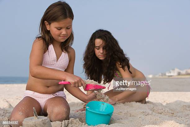 Girls playing in sand on beach