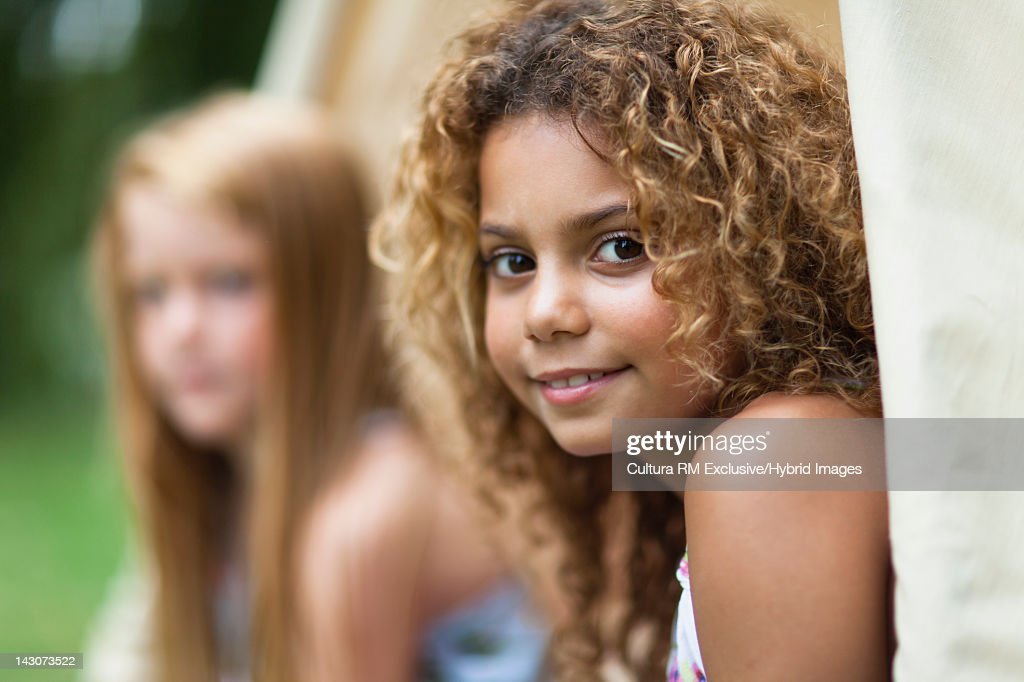 Girls playing in tent outdoors : Stock Photo