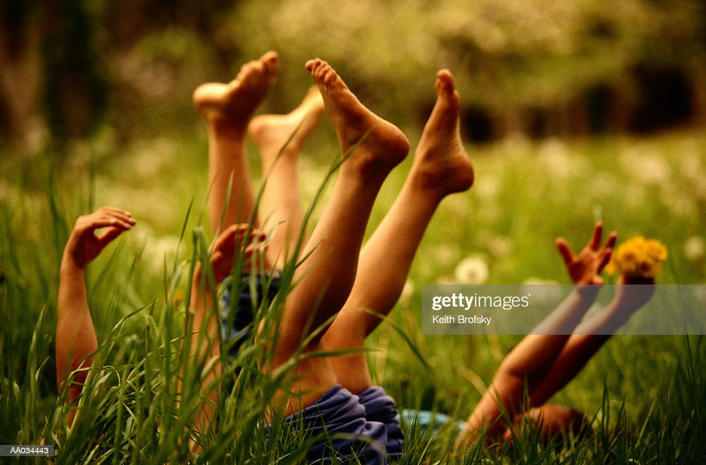 Girls Playing in the Grass : Stock Photo