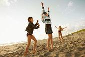 Girls playing on beach