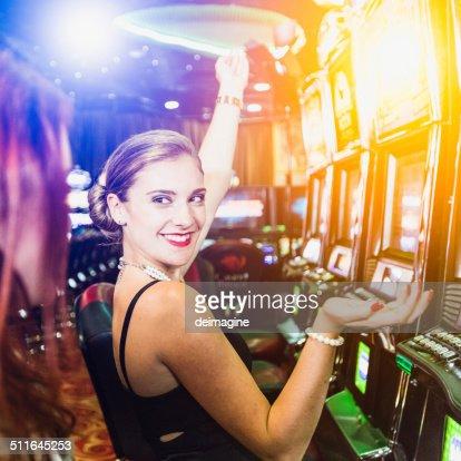 Girls playing slot machine in the casino