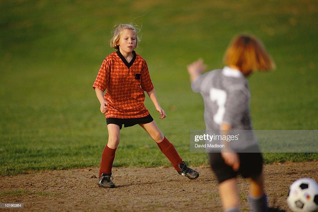 Girls (9-12) playing soccer : Stock Photo