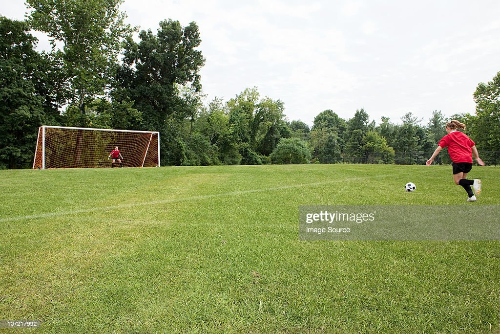 Girls playing soccer : Stock Photo