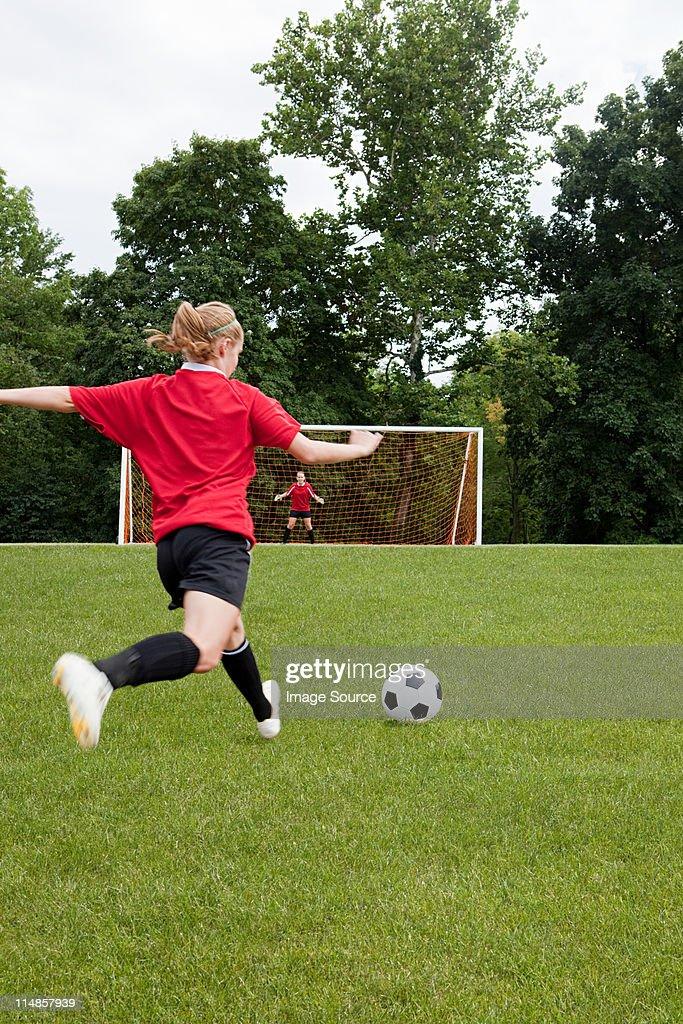Girls playing soccer : Stock Photo