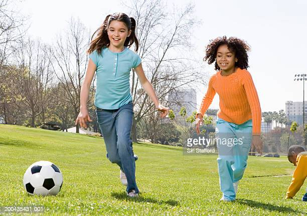 Girls (8-10) playing soccer