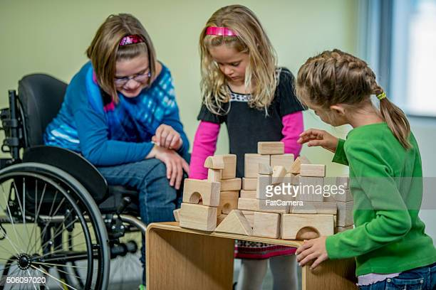 Girls Playing with Wooden Blocks