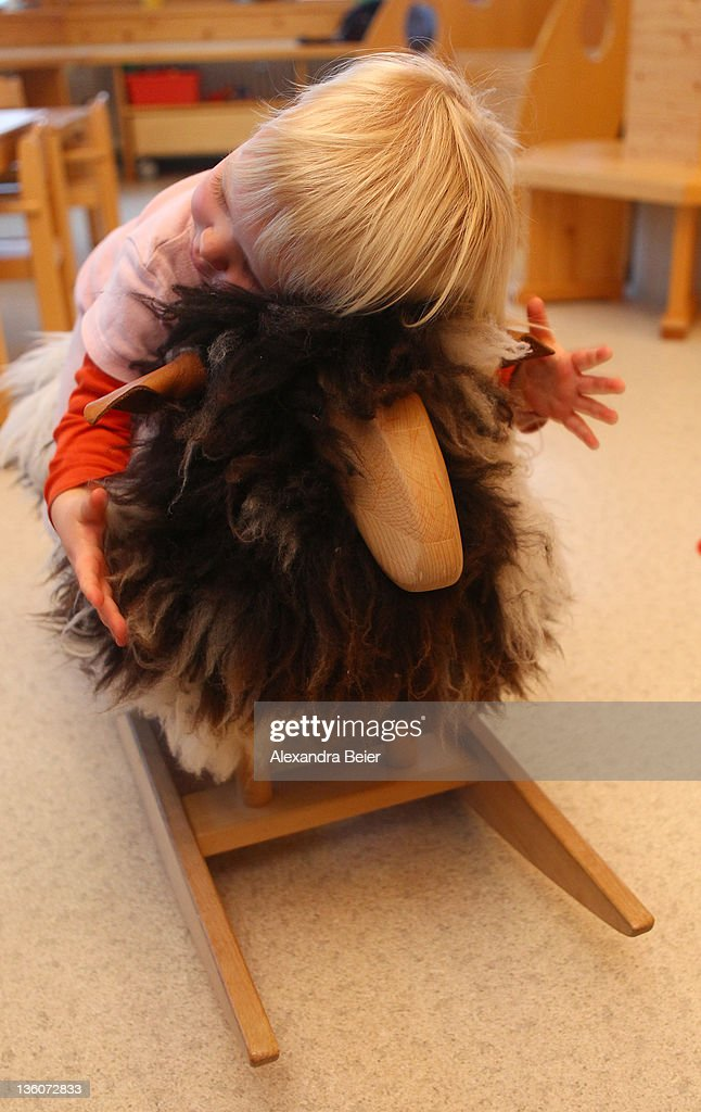 A girls plays with a rocking sheep at a day care center for children aged 12 months to six years on December 22, 2011 in Munich, Germany. German authorities claim the country will need to increase the capacity of its child day care centers by at least an additional 230,000 by 2013.