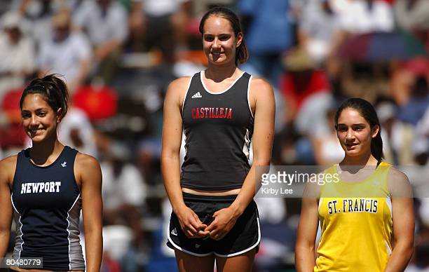 Girls pole vautl winner Tori Anthony of Castilleja High is flanked by runnerup Natasha Barthel of Mountain View St Francis and thirdplace finisher...