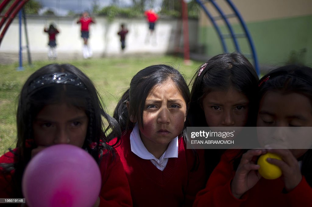 Girls pose at a rural school at La Palizada in Tulcan, Carchi province, in Ecuador close to the Colombian border on November 7, 2012. AFP PHOTO/Eitan Abramovich