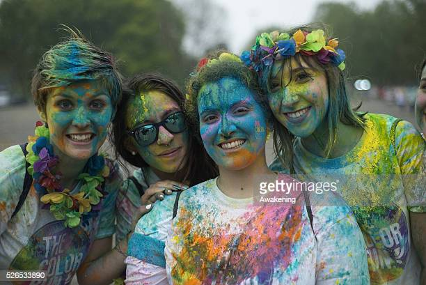 Girls pose at Color Run on April 30 2016 in Turin The Color Run is a noncompetitive event that takes place in Turin with music flowers and colors in...
