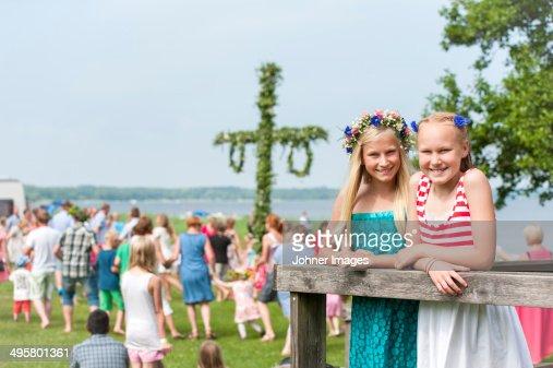 Girls posing with maypole in background, Ronneby, Blekinge, Sweden