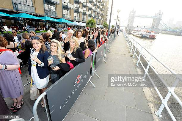 Girls queue up to participate in the live casting session as they attend Martini Launches The 'Martini Royale Casting' with Designer Christian...