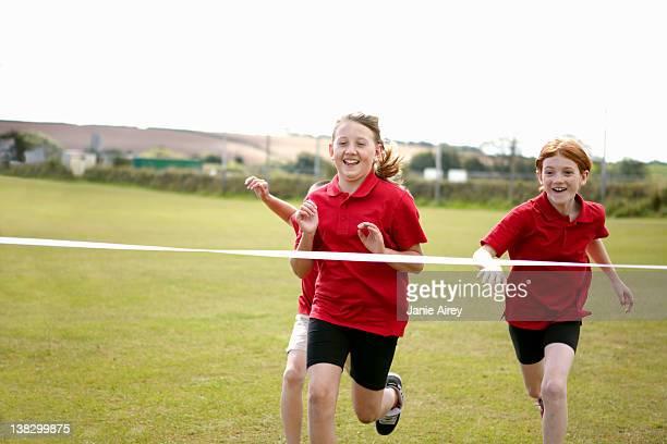 Girls racing to cross finish line
