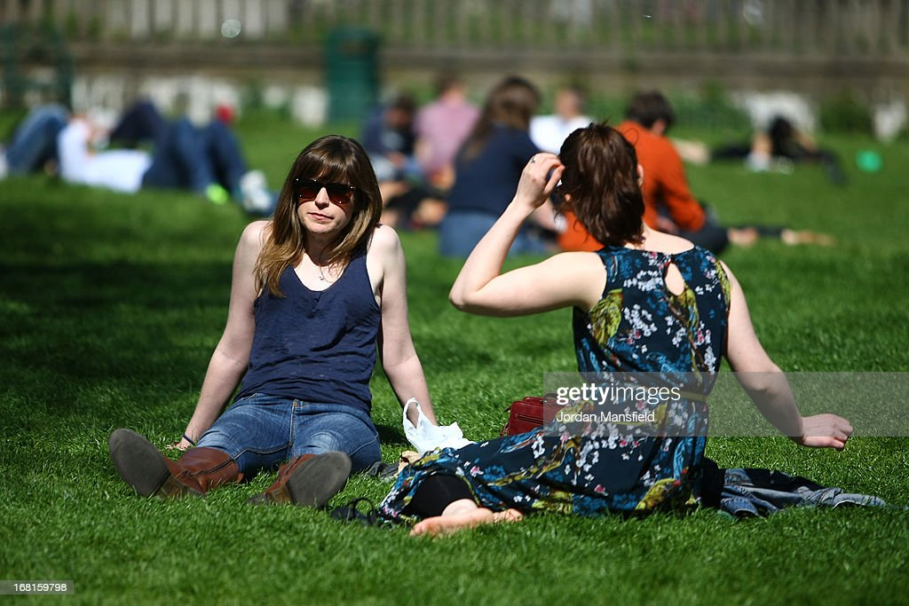 Girls relax in the sun in the Pavilion Gardens on May 6, 2013 in Brighton, England. Visitors have flocked to Brighton Beach as the Met Office predicted the May Day Bank Holiday to be the hottest day of the year so far.