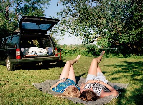 Girls relaxing on grass