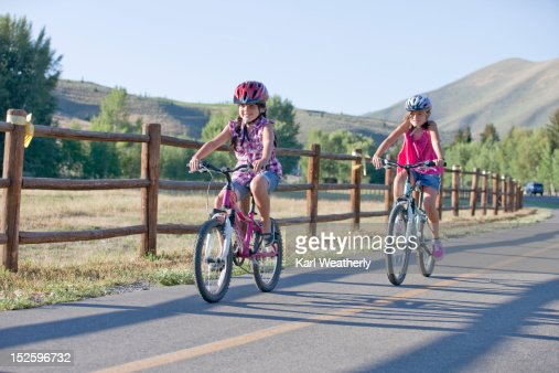 Girls riding bikes on bike path : Stock Photo