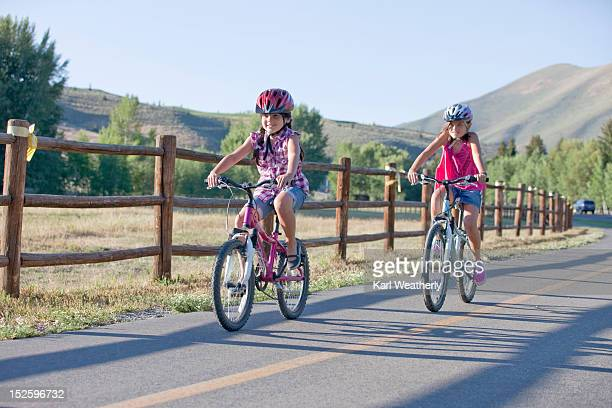 Girls riding bikes on bike path