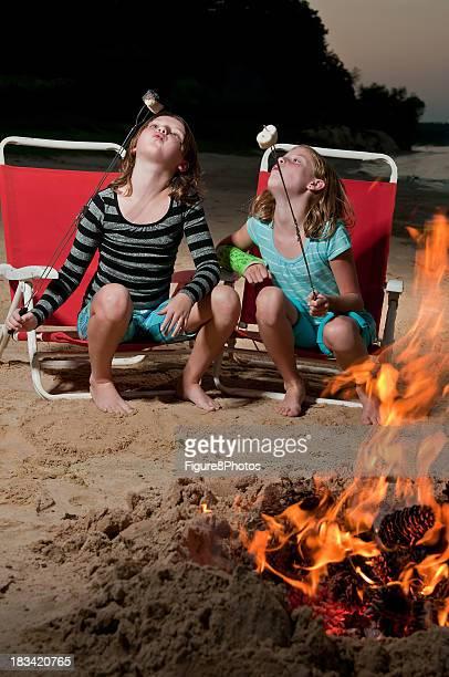 Girls roasting marshmallows