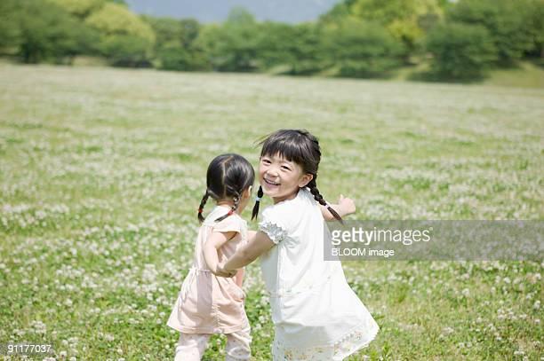 Girls running in field