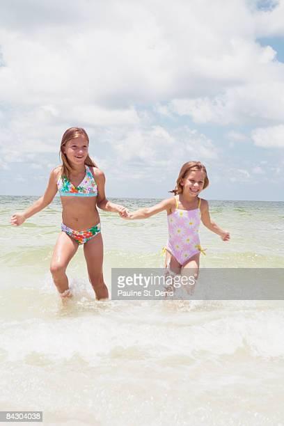 Girls running in ocean
