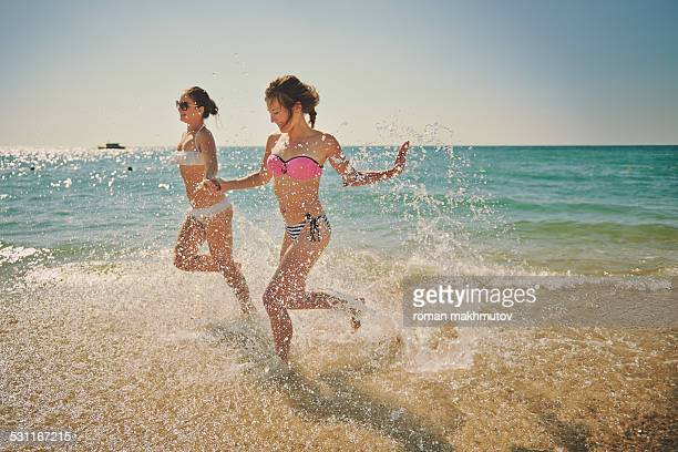 Girls running in the shallow water