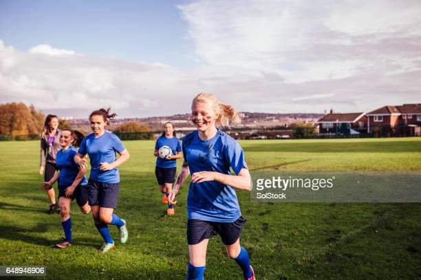 Girls Running off a Soccer Playing Field