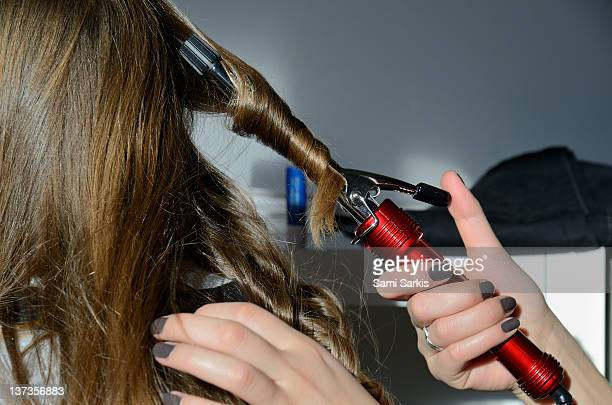 Girls setting hairstyle, close-up