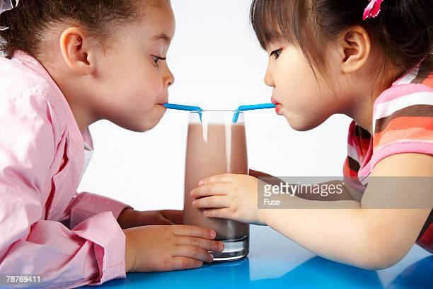 Girls Sharing Chocolate Milk