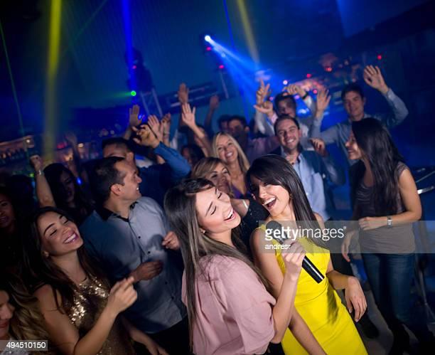 Girls singing at a nightclub