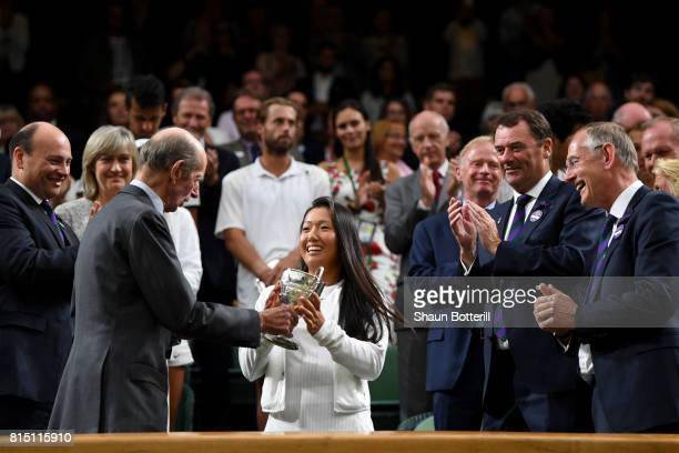 Girl's Singles final winner Claire Liu of the United States is presented with her trophy by The Duke of Kent on centre court on day twelve of the...