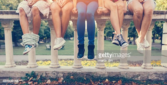 Girls sitting in a row